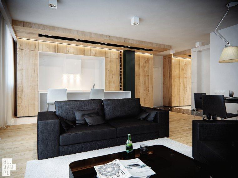Połączenie czerni i bieli z dodatkiem naturalnego drewna nadało mieszkaniu dojrzałego i wysmakowanego charakteru.