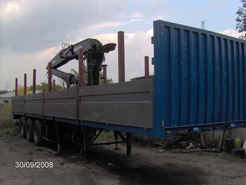 HDS dźwig leśny Jonsered 1800 zamontowany na naczepie