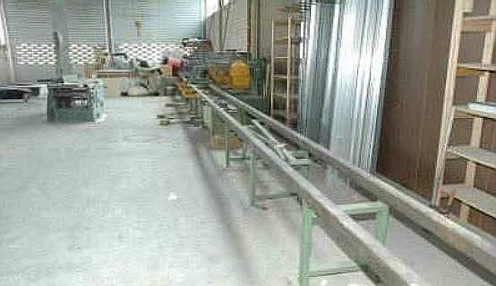 Linia do produkcji domów z bali FESTO z podajnikie
